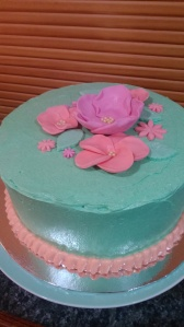 "9"" large double layer Koko Samoa Cake with fondant flowers and vanilla buttercream"